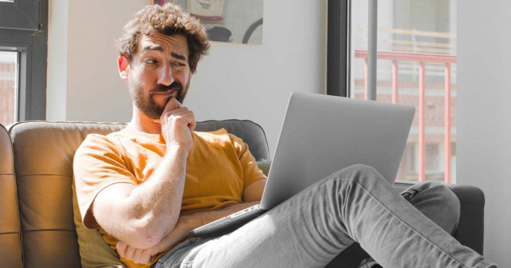 Man with laptop wondering how important are blogs are to SEO